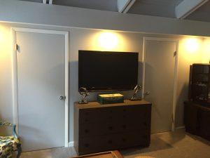 Swivel mount TV in bedroom above dresser -